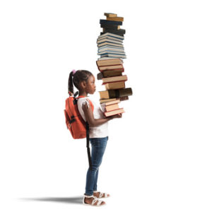 Child with backpack and a books pile