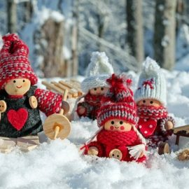 Dolls dressed up for the snow